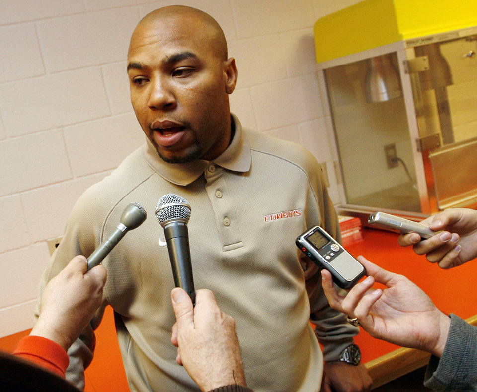 Photo - Robert Gillespie, former South Carolina running backs coach who has joined the OSU college football staff, answers questions from the media in the media room at Gallagher-Iba Arena on the campus of Oklahoma State University in Stillwater, Okla., Friday, January 23, 2009. BY NATE BILLINGS, THE OKLAHOMAN ORG XMIT: KOD