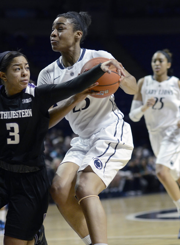 Photo - Penn State's Ariel Edwards (23) looks for a shot around Northwestern's Ashley Deary (3) during the first half of an NCAA basketball game in State College, Pa., Thursday, Feb. 20, 2014. (AP Photo/Ralph Wilson)