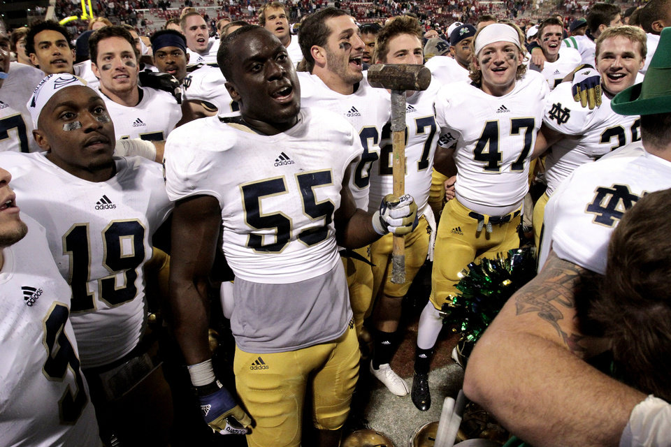 Notre Dame linebacker Prince Shembo (55) holds a sledge hammer as he and teammates celebrate after the college football game where the University of Oklahoma Sooners (OU) were defeated by the Fighting Irish of Notre Dame (ND) 30-13 at Gaylord Family-Oklahoma Memorial Stadium in Norman, Okla., on Saturday, Oct. 27, 2012. Photo by Steve Sisney, The Oklahoman