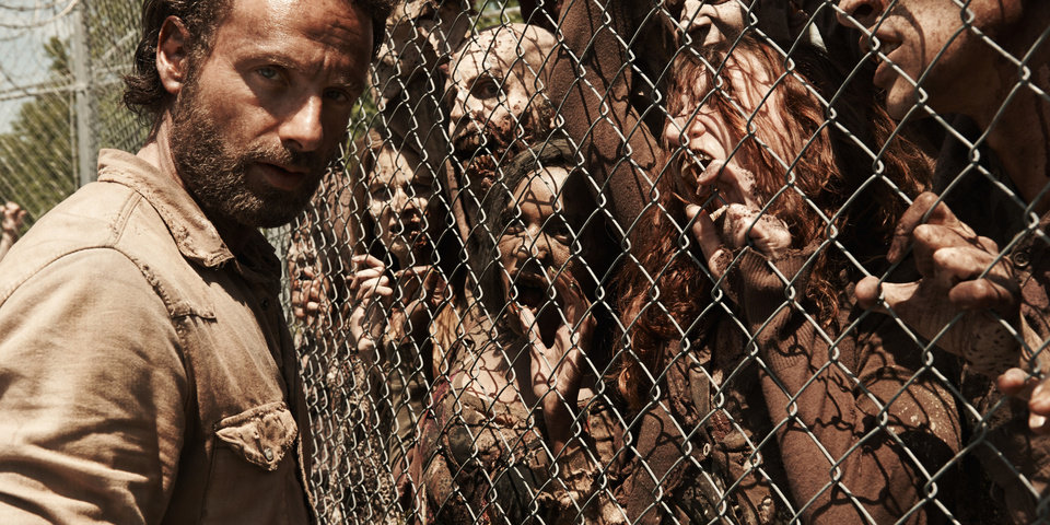 Photo -  Rick Grimes, played by Andrew Lincoln, confronts a wall of zombies in a photo from season four of