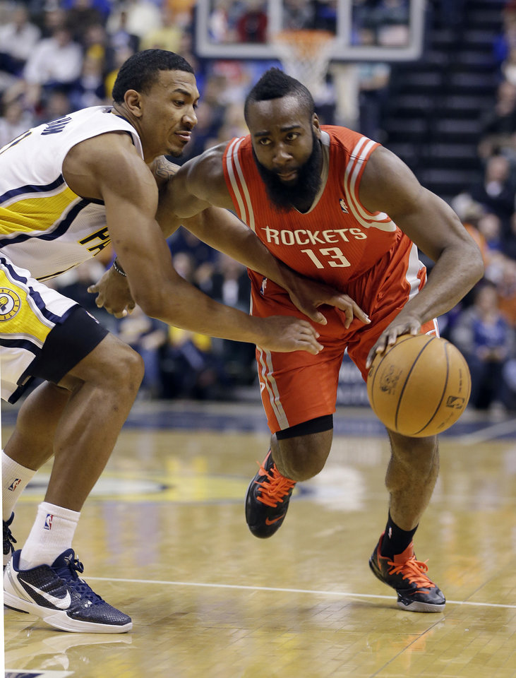 Photo - Houston Rockets' James Harden (13) goes to the basket against Indiana Pacers' Orlando Johnson during the first half of an NBA basketball game Friday, Jan. 18, 2013, in Indianapolis. (AP Photo/Darron Cummings)