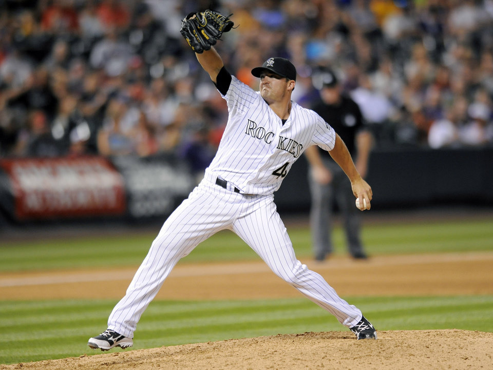 Photo - Colorado Rockies relief pitcher Rex Brothers throws in the seventh inning of a baseball game against the Washington Nationals on Tuesday, July 22, 2014, in Denver. (AP Photo/Chris Schneider)