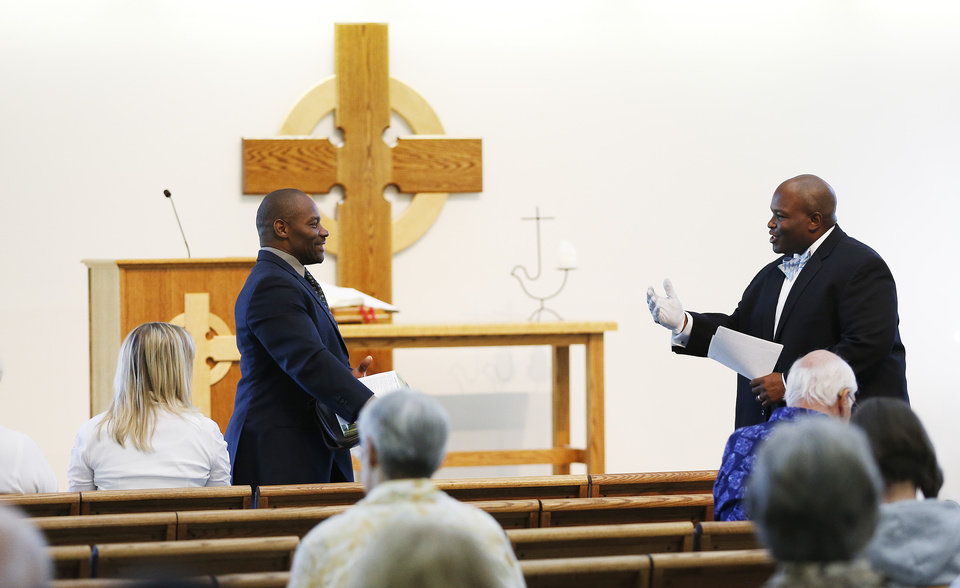 Photo -       Rev. Jerrod Lowry, right, introduces Pastor Ron Williams at the Community of Grace Presbyterian Church in Sandy, Utah, Sunday, Aug. 17, 2014. Williams, a nondenominational Christian pastor, has written books about fitness, food and faith. (Jeffrey D. Allred, Deseret News)