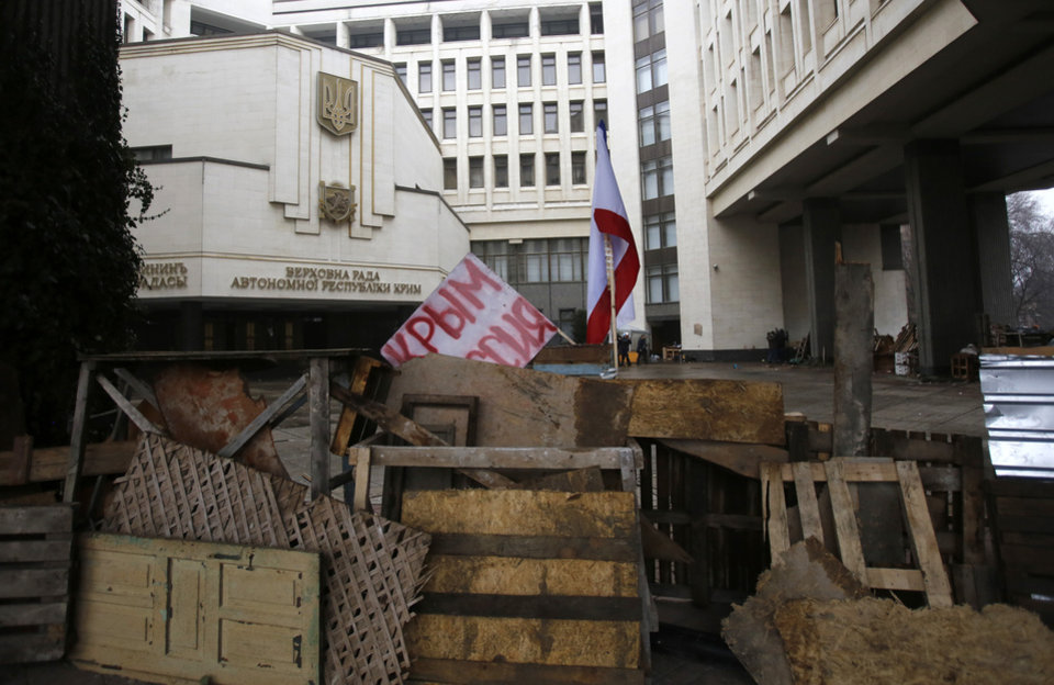 Photo - Barricades in front of local government building with banner which reeds: 'Crimea Russia