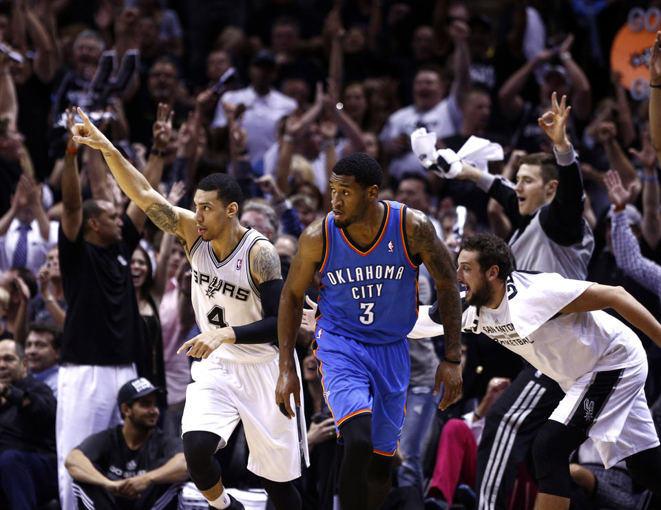 Photo - San Antonio's Danny Green (4) celebrates his 3-point shot in front of Oklahoma City's Perry Jones (3) during Game 2 of the Western Conference Finals in the NBA playoffs between the Oklahoma City Thunder and the San Antonio Spurs at the AT&T Center in San Antonio, Wednesday, May 21, 2014. Photo by Sarah Phipps