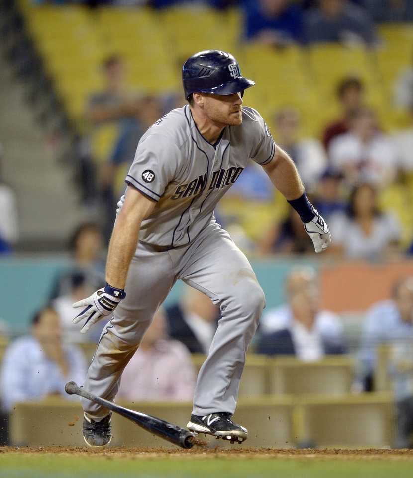 Photo -   San Diego Padres' Logan Forsythe hits an RBI single during the 11th inning of their baseball game against the Los Angeles Dodgers, Tuesday, Sept. 4, 2012, in Los Angeles. (AP Photo/Mark J. Terrill)