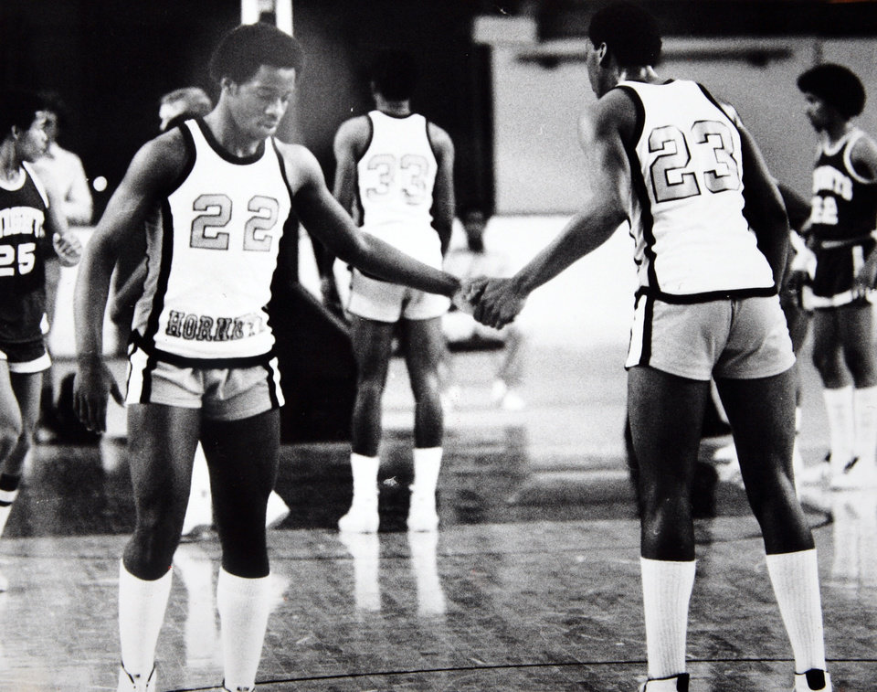 Former OU basketball player Wayman Tisdale. The Tisdale brothers from Tulsa Washington, William (left) and Wayman, clasp hands during their win over Northwest. Photo by Jim Argo. Photo taken 3/12/ 1981, photo published 3/13/1981 in Oklahoma City Times. ORG XMIT: KOD