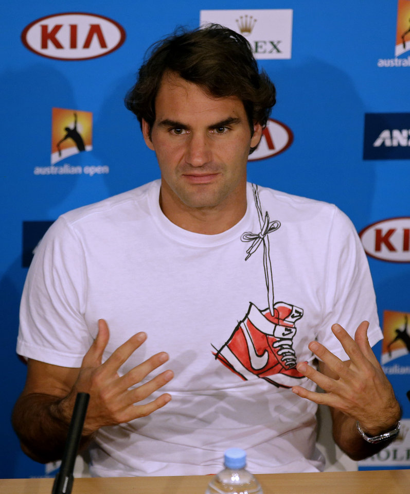 Photo - Roger Federer of Switzerland speaks during a press conference after his semifinal loss to Rafael Nadal of Spain at the Australian Open tennis championship in Melbourne, Australia, Friday, Jan. 24, 2014. (AP Photo/Aijaz Rahi)