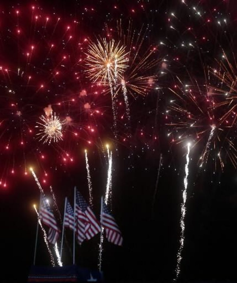 Fireworks burst over Addison, Texas during the Kaboom Town Independence Day celebration on Wednesday, July 3, 2013 at Addison Circle Park. (AP Photo/The Dallas Morning News, Michael Ainsworth)