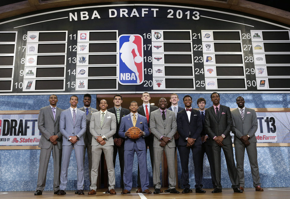 Members of the 2013 NBA basketball draft class pose together before the first round of the draft, Thursday, June 27, 2013, in New York. (AP Photo/Kathy Willens) ORG XMIT: NYJD101