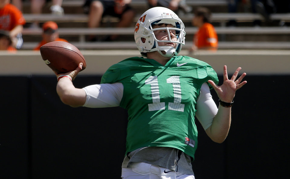Oklahoma State's Wes Lunt throws a pass during OSU's spring football game at Boone Pickens Stadium in Stillwater, Okla., Sat., April 20, 2013. Photo by Bryan Terry, The Oklahoman