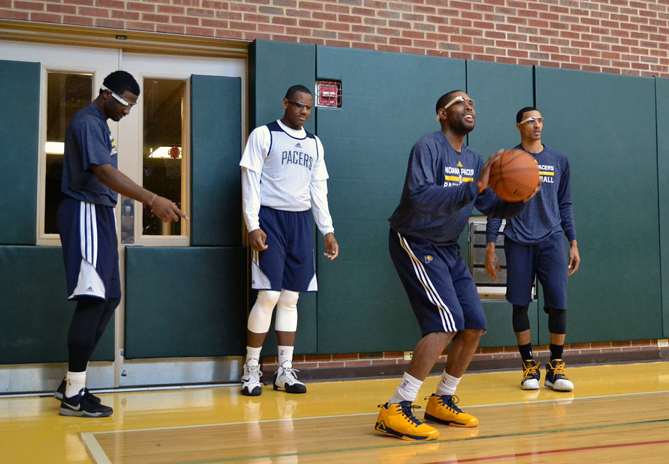 Photo -   Indiana Pacers basketball players, from left, Solomon Hill, Lavoy Allen, C.J. Watson and George Hill wear Google glasses during practice at Bankers Life Fieldhouse in Indianapolis.  AP File Photos   Celeste ballou -  AP