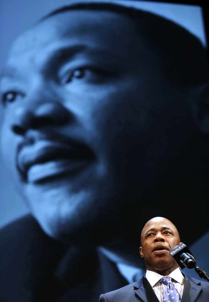 Photo - Newly elected Brooklyn borough president Eric Adams speaks at a tribute to Martin Luther King, Jr. in the Brooklyn borough of New York, Monday, Jan. 20, 2014. Mayor Bill de Blasio told a packed audience Monday at the Brooklyn Academy of Music that the