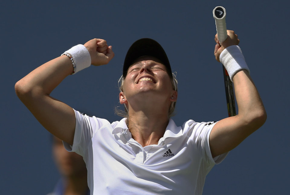 Photo - Johanna Larsson, of Sweden, reacts after defeating Sloane Stephens, of the United States, during the second round of the 2014 U.S. Open tennis tournament, Wednesday, Aug. 27, 2014, in New York. (AP Photo/Matt Rourke)