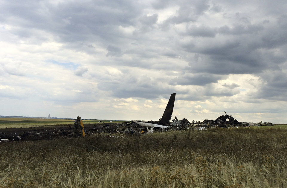 Photo - Remnants of a downed Ukrainian army aircraft Il-76 at  the airport near Luhansk, Ukraine, Saturday, June 14, 2014. Pro-Russian separatists shot down the military transport plane Saturday in the country's restive east, killing all 49 service personnel on board, Ukrainian officials said. (AP Photo/Evgeniy Maloletka)