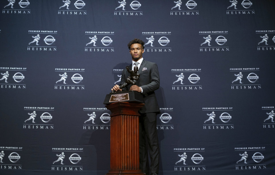 Photo - Oklahoma quarterback Kyler Murray poses with the Heisman Trophy after winning the award Saturday, Dec. 8, 2018, in New York. (AP Photo/Craig Ruttle)