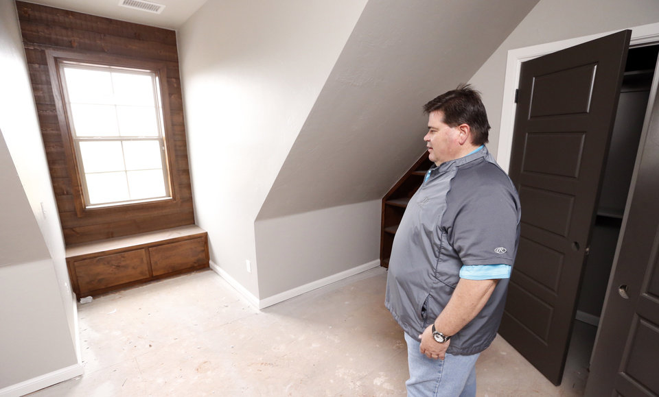 Photo -  Tony Foust of DaVinci Homes shows a bedroom in the home he built at 2017 Providence Drive for the Festival of Homes organized by the Builders Association of South Central Oklahoma and Moore Home Builders Association. The event is Friday through June 7 and June 12-14 with 35 new houses in the Norman and Moore areas open free to the public from 1 to 7 p.m. PHOTO BY STEVE SISNEY, THE OKLAHOMAN   STEVE SISNEY -  THE OKLAHOMAN