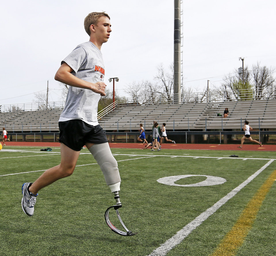 Norman's Patrick Ahearn warms up for the 400-meter dash during a track meet at Putnam City High School in Oklahoma City, Friday, April 5, 2013. Ahearn lost part of his leg in a personal watercraft accident last year. Photo by Nate Billings, The Oklahoman