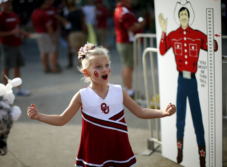 Cayden Sadler, 6, of Edmond reacts after seeing a ride at the State Fair of Texas before the Red River Rivalry college football game between the University of Oklahoma Sooners and the University of Texas Longhorns at the Cotton Bowl Stadium in Dallas, Saturday, Oct. 12, 2013. Photo by Bryan Terry, The Oklahoman