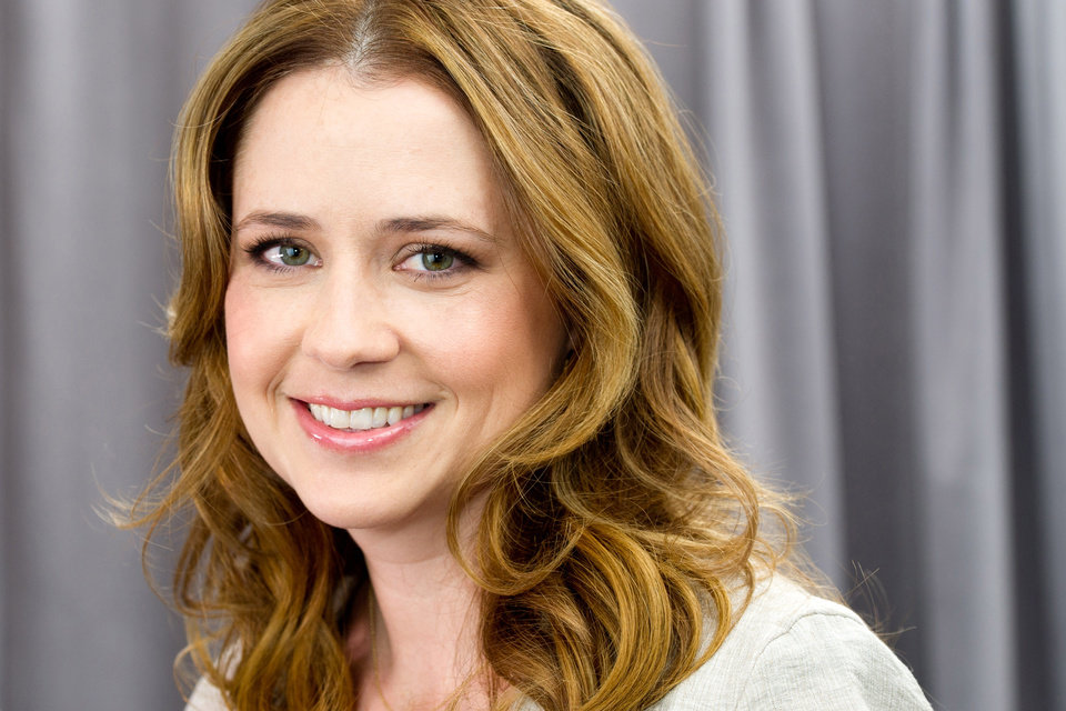 In this April 24, 2012 photo, actress Jenna Fischer poses for a portrait in New York. In her latest project, a romantic comedy called �The Giant Mechanical Man,� Fischer's character Janice is a down on her luck, single woman who can't seem to get her life together. She ends up falling for a street performer played by Chris Messina. (AP Photo/Charles Sykes)