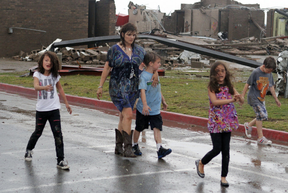 Children walk away from Briarwood Elementary school after a tornado destroyed the school in south OKC Oklahoma City, OK, Monday, May 20, 2013. Near SW 149th and Hudson. By Paul Hellstern, The Oklahoman