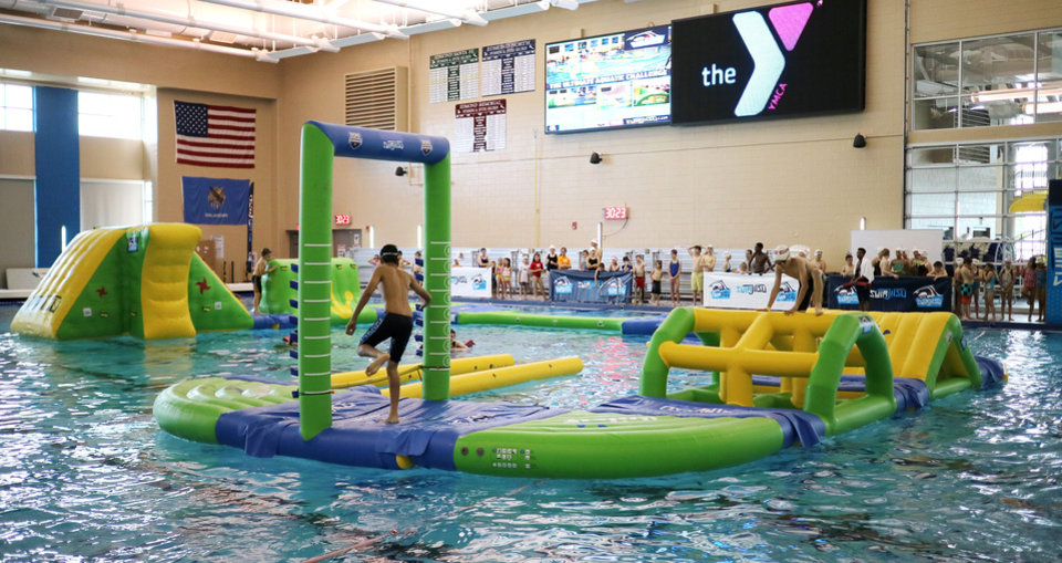 Swimmers try their skills at swimjitsu in edmond news ok for Garden city ymca pool schedule