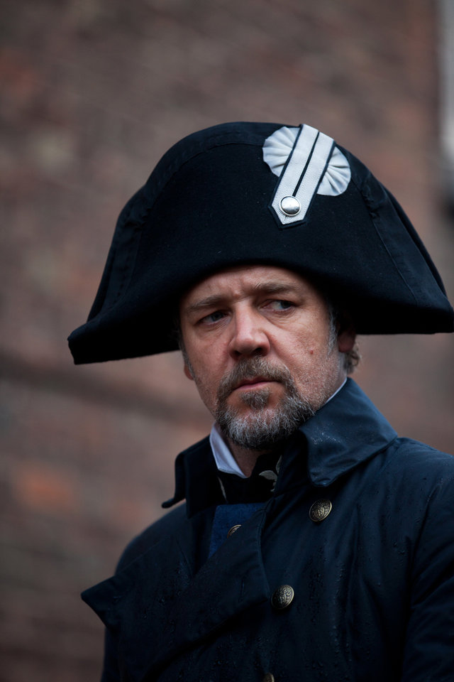 "This undated publicity image provided by Universal Pictures shows Russell Crowe as Javert, center, in a scene from the motion-picture adaptation of ""Les Misérables,� directed by Tom Hooper. A familiar lineup of Hollywood awards contenders are expected among Golden Globe nominations coming out Thursday morning, Dec. 13, 2012, whose prospects include past Oscar winners Daniel Day-Lewis, Helen Mirren, Robert De Niro and Sally Field. Other Oscar recipients may be nominated, such as Mirren and Anthony Hopkins for �Hitchcock,� Philip Seymour Hoffman for �The Master,� Helen Hunt for �The Sessions,� Marion Cotillard for �Rust and Bone,� Russell Crowe for �Les Miserables� and Alan Arkin for �Argo.� (AP Photo/Universal Pictures, Laurie Sparham)"