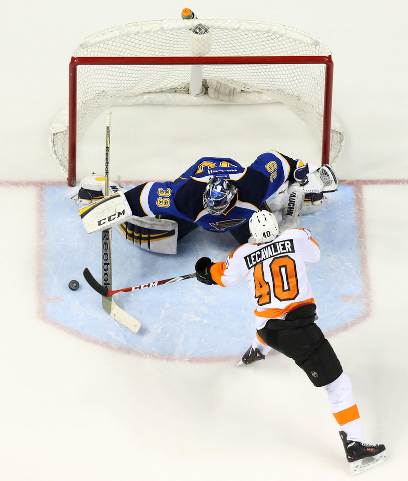 Photo - St. Louis Blues goaltender Ryan Miller stops a shot by Philadelphia Flyers center Vincent Lecavalier in a shootout during a game between the St. Louis Blues and the Philadelphia Flyers on Tuesday, April 1, 2014, at the Scottrade Center in St. Louis. (AP Photo/St. Louis Post-Dispatch, Chris Lee)