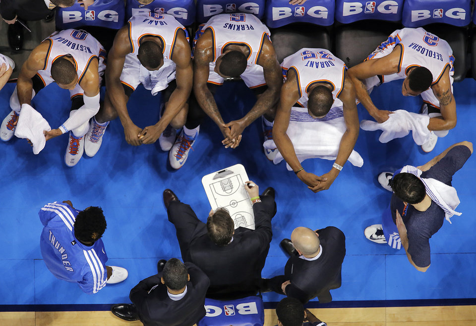 Coach Scott Brooks talks to the team during a time out during the NBA basketball game between the Oklahoma City Thunder and the Utah Jazz at Chesapeake Energy Arena on Wednesday, March 13, 2013, in Oklahoma City, Okla. Photo by Chris Landsberger, The Oklahoman