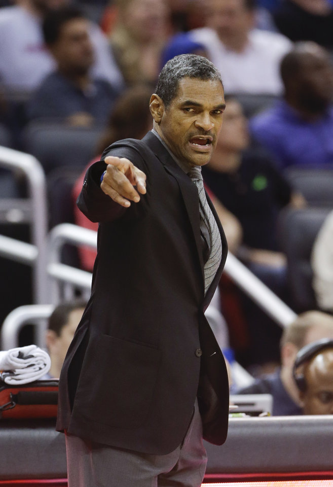 Photo - Detroit Pistons head coach Maurice Cheeks directs his players against the Orlando Magic during the first half of an NBA basketball game in Orlando, Fla., Friday, Dec. 27, 2013. (AP Photo/John Raoux)