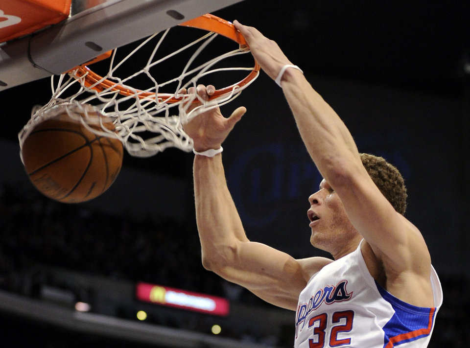 Photo - Los Angeles Clippers power forward Blake Griffin dunks the ball during the first half of their NBA basketball game against the Charlotte Bobcats, Saturday, Jan. 29, 2011, in Los Angeles.  (AP Photo/Mark J. Terrill)
