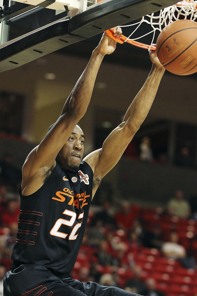 Photo - Oklahoma State's Markel Brown dunks against Texas Tech during their NCAA college basketball game in Lubbock, Texas, Tuesday, Jan. 31, 2012. (AP Photo/The Lubbock Avalanche-Journal, Zach Long)