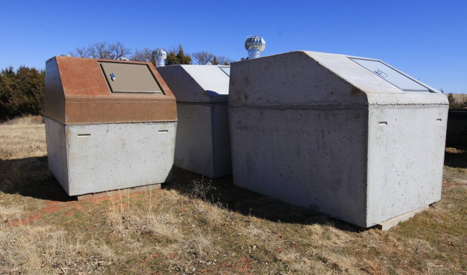 Photo - Storm shelters ready for delivery at Biggs Storm Shelters in Piedmont.   Photo by Paul B. Southerland, The Oklahoman  PAUL B. SOUTHERLAND -