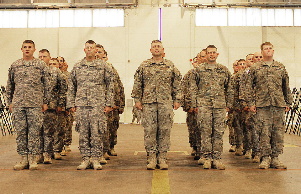 Members of the 45th Infantry Brigade stand at attention during a welcome home ceremony for the National Guard 45th Infantry Brigade at Will Rogers Air National Guard in Oklahoma City, Sunday, April 1, 2012.  Photo by Garett Fisbeck, For The Oklahoman