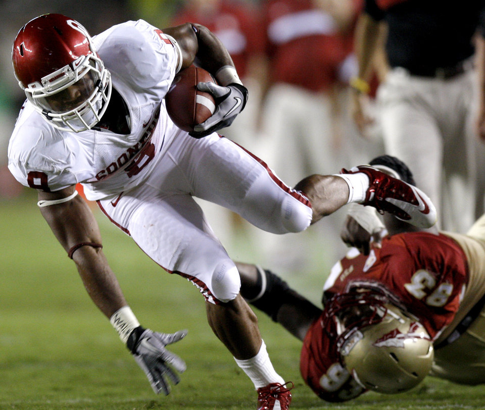 Oklahoma's Dominique Whaley (8) runs past Florida's Bert Reed (83) during a college football game between the University of Oklahoma (OU) and Florida State (FSU) at Doak Campbell Stadium in Tallahassee, Fla., Saturday, Sept. 17, 2011. Photo by Bryan Terry, The Oklahoman