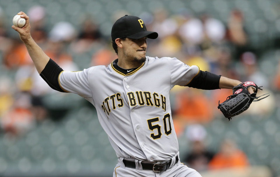 Photo - Pittsburgh Pirates starting pitcher Charlie Morton throws to the Baltimore Orioles in the first inning in the first baseball game of a doubleheader on Thursday, May 1, 2014, in Baltimore. (AP Photo/Patrick Semansky)