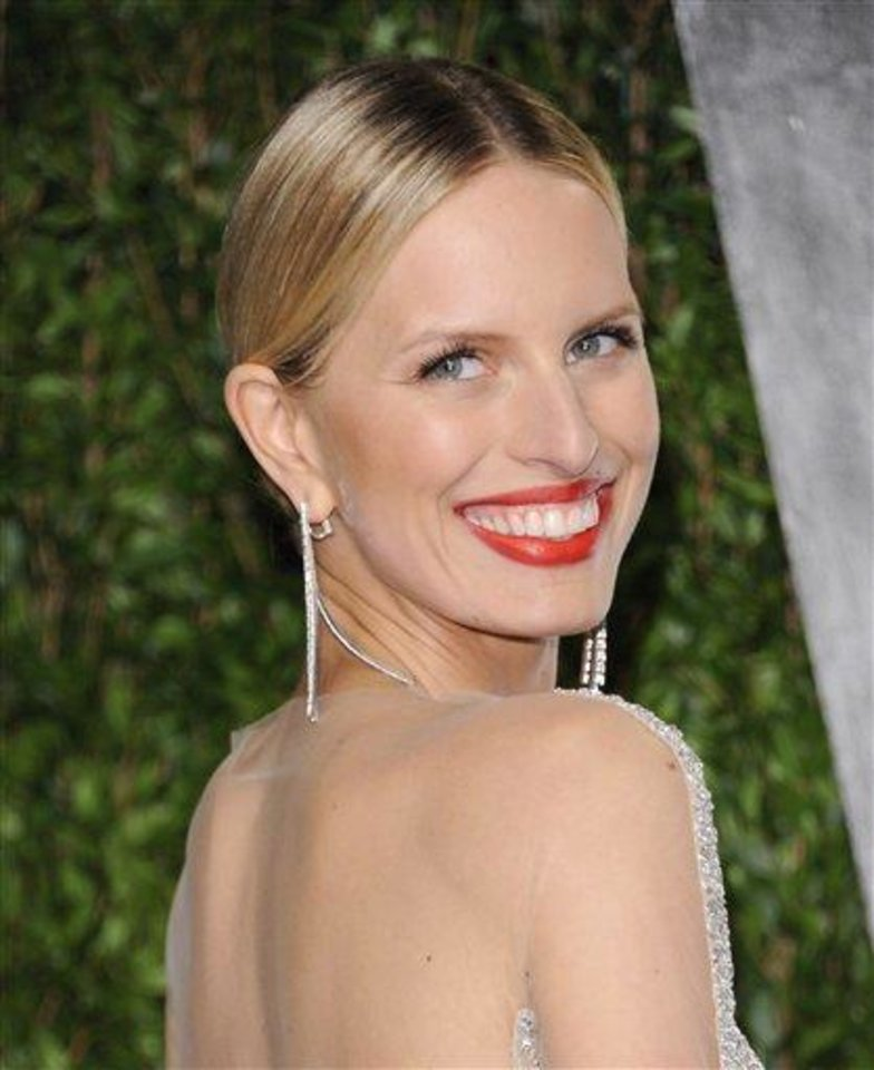 Photo - FILE - This Feb. 26, 2012 file photo shows model Karolina Kurkova at the Vanity Fair Oscar party in West Hollywood, Calif.  Oxygen Media announced Wednesday that 28-year-old Kurkova will be the third coach on the new reality competition for up-and-coming models, working alongside Naomi Campbell and Coco Rocha. Photographer Nigel Barker, the former judge from