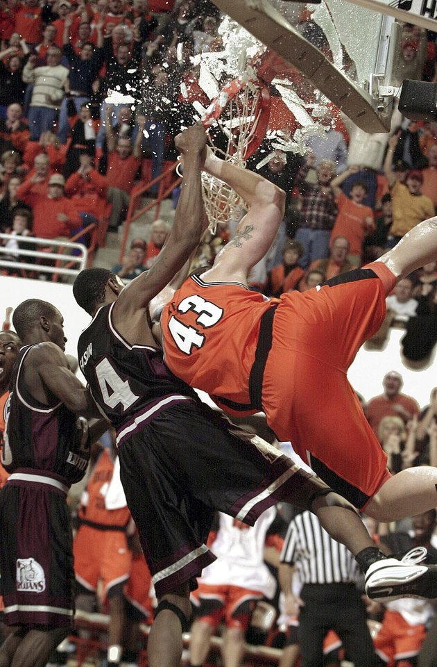 Former OSU center Jason Keep (43) breaks a backboard in 2000 at Gallagher-Iba Arena. AP Photo
