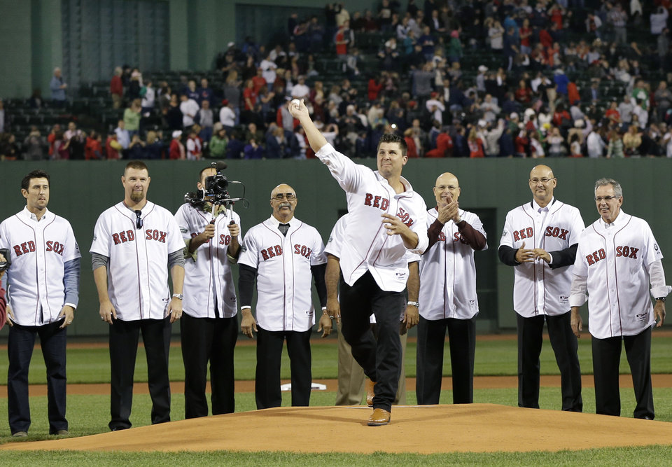 Photo -   Members of the 2004 World Series Championship Boston Red Sox, including manager Terry Francona, second from right, watch as pitcher Keith Foulke throws a ceremonial first pitch as they are honored at Fenway Park before a baseball game against the Tampa Bay Rays in Boston, Tuesday, Sept. 25, 2012. (AP Photo/Elise Amendola)
