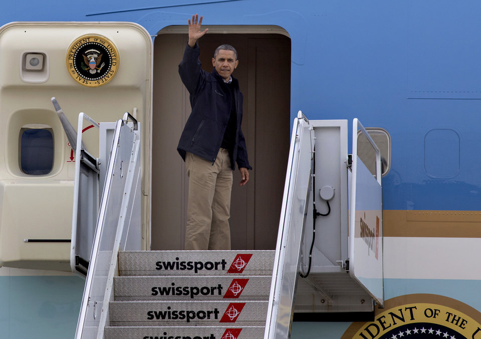 <p>President Barack Obama waves as he boards Air Force One at JFK International Airport in New York, Thursday, Nov. 15, 2012, after touring, both by air and on the ground, parts of New York that were severely impacted by Superstorm Sandy. (AP Photo/Craig Ruttle)</p>