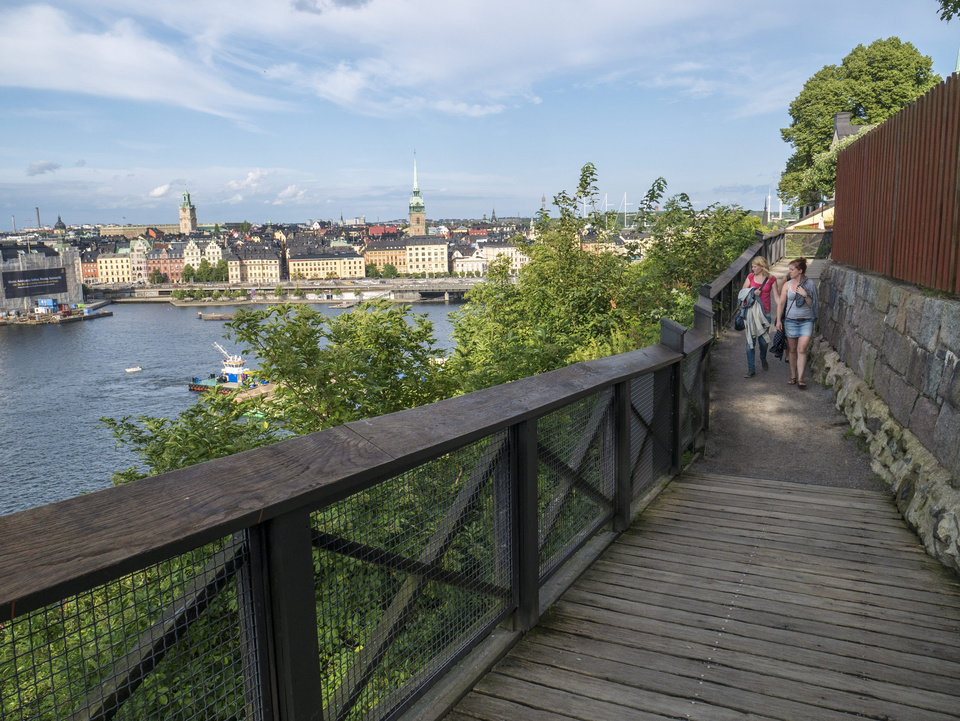 Photo - This Aug. 7, 2014  file photo shows people walking along the Monteliusvagen  path on the cliffs over the northern shore of the Sodermalm district in Stockholm.  (AP Photo/Per Gustavsson, File)