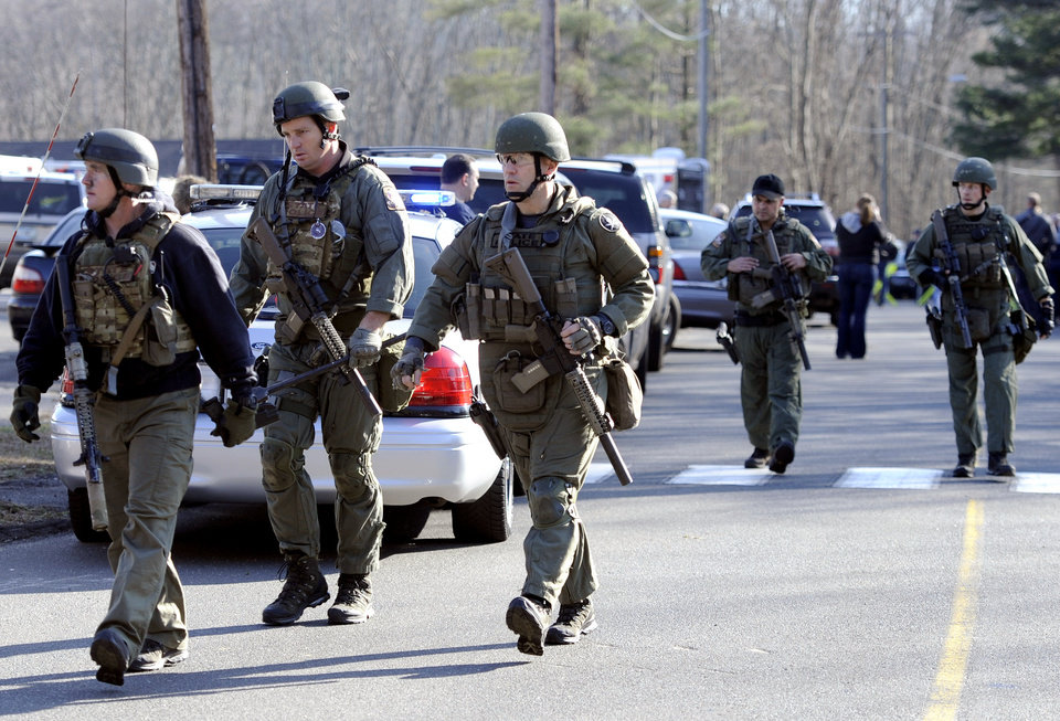 State Police are on scene following a shooting at the Sandy Hook Elementary School in Newtown, Conn., about 60 miles (96 kilometers) northeast of New York City, Friday, Dec. 14, 2012. An official with knowledge of Friday's shooting said 27 people were dead, including 18 children. (AP Photo/Jessica Hill)
