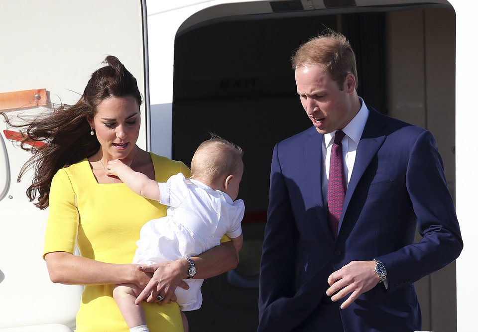 Britain's Prince William with his wife Kate, Duchess of Cambridge, and Prince George, arrives in Sydney Wednesday, April 16, 2014. The royal couple are on a three-week tour of Australia and New Zealand, the first official trip overseas with their son, Prince George. (AP Photo/Rob Griffith)