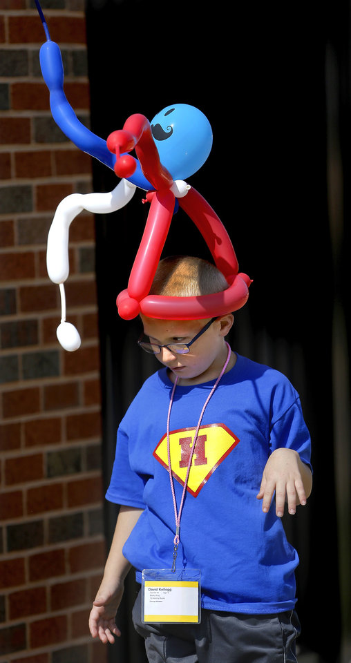 Photo - David Kellogg, 9, of Hominy, wears a balloon. Clowns donated their time to make balloon hats for participants. by Special Olympics athletes numbering in the thousands are competing in various events today and tomorrow  in Stillwater as the organization's 45th Annual Summer Games are held in Oklahoma this week.  Officials say more than 4,600 Special Olympics Oklahoma athletes have registered to compete this year, and thousands of volunteers are assisting during the three days of competitions.   This is the 31st year the summer games has been centered at Oklahoma State University.  Special Olympics is the world's largest sports organization for children and adults with intellectual disabilities, providing year-round training and competitions to more than 4.2 million athletes in 170 countries, according to their web site. Photo by Jim Beckel, The Oklahoman