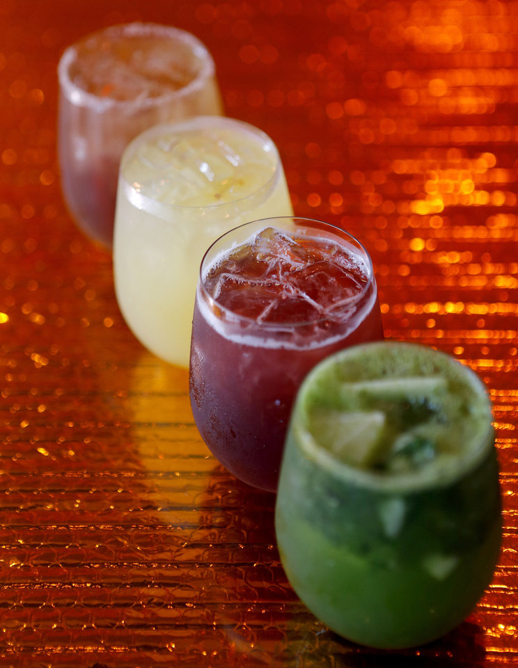 Photo - From right, Gin Salad, Lilith, Saffron Lemonade, and Lumberjack cocktails are seen at the Saturn Grill's newest location is in Oklahoma City's Midtown. Photo by Bryan Terry, The Oklahoman  Bryan Terry - THE OKLAHOMAN
