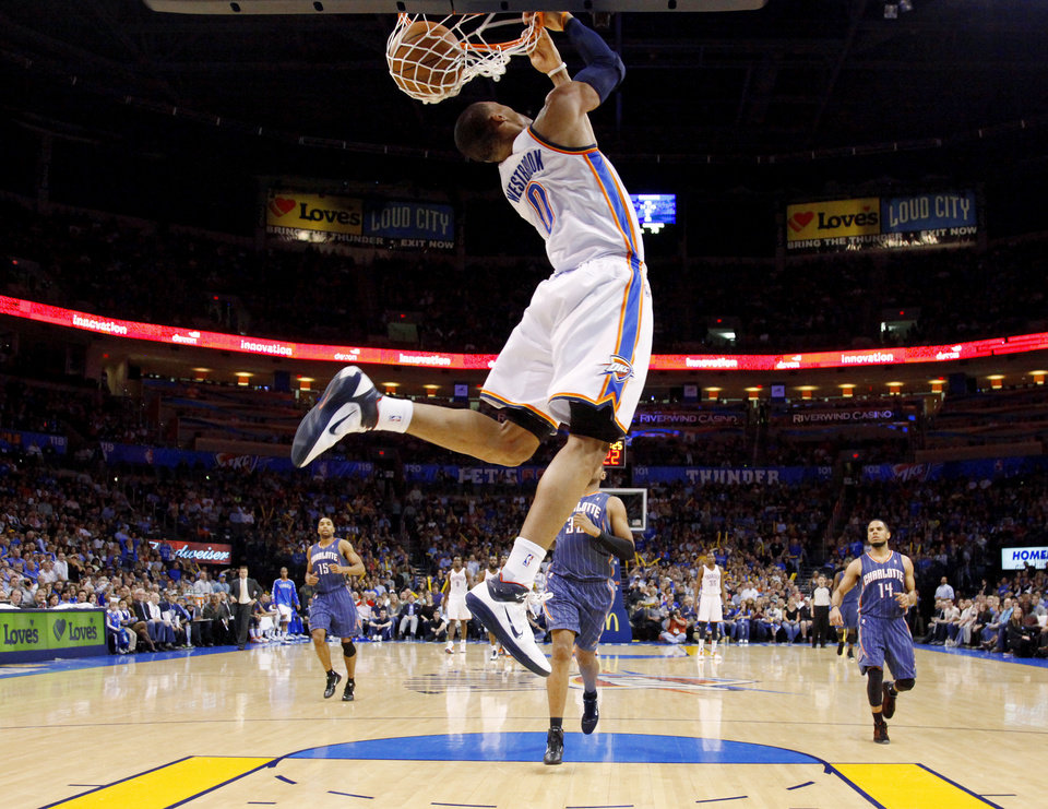 Oklahoma City\'s Russell Westbrook (0) dunks the ball during an NBA basketball game between the Oklahoma City Thunder and the Charlotte Bobcats at the Oklahoma City Arena, Friday, March 18, 2011. Photo by Bryan Terry, The Oklahoman