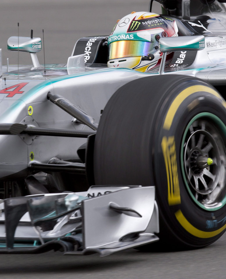 Photo - Mercedes driver Lewis Hamilton from Great Britain during the first practice session Friday, June 6, 2014, at the Canadian Grand Prix in Montreal.  (AP Photo/The Canadian Press, Jacques Boissinot)