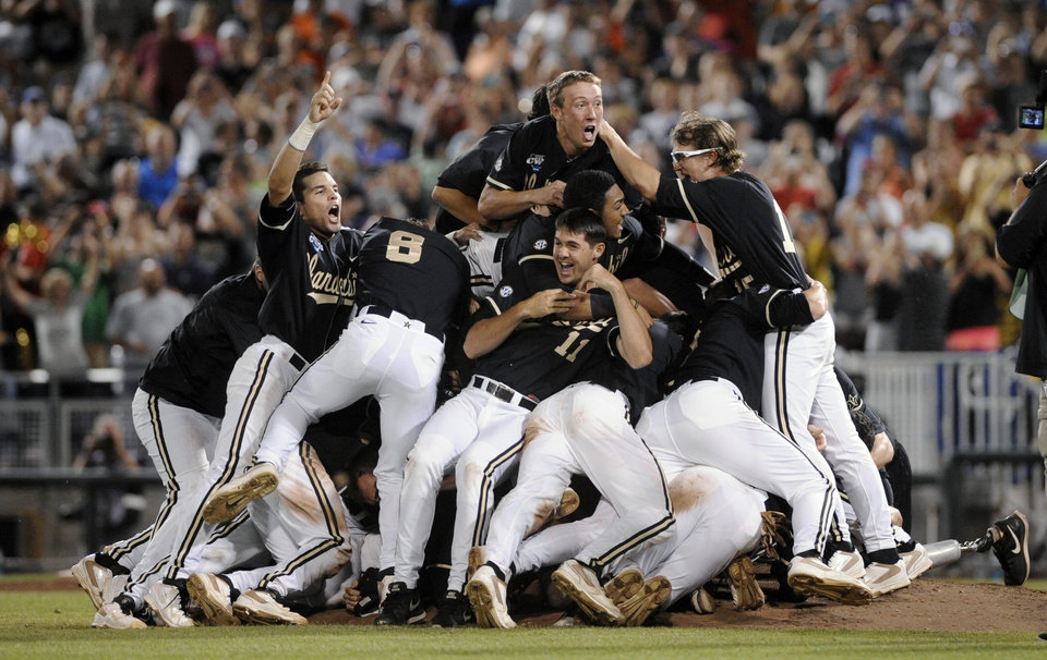 Photo - Vanderbilt players celebrate after Vanderbilt defeated Virginia 3-2 in the deciding game of the best-of-three NCAA baseball College World Series finals in Omaha, Neb., Wednesday, June 25, 2014. (AP Photo/Eric Francis)