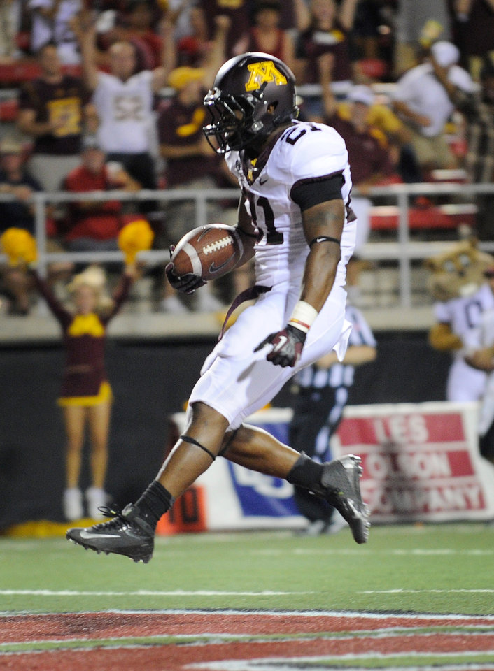 Photo -   Minnesota's Brock Vereen (21) trots in for his first half touchdown against UNLV during his NCAA college football game at Sam Boyd Stadium, Thursday, Aug. 30, 2012 in Las Vegas. (AP Photo/David Becker)