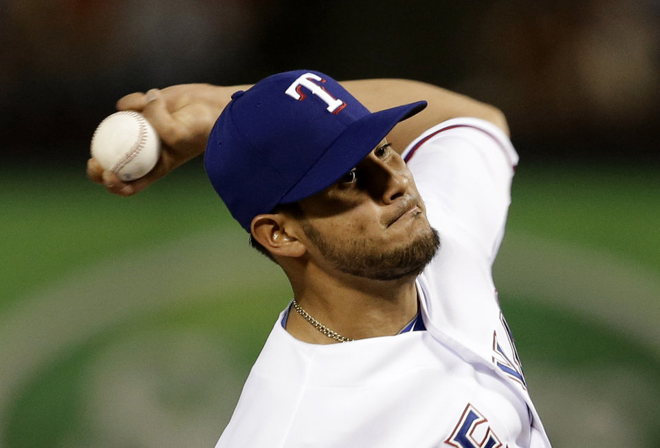 Photo - Texas Rangers starting pitcher Martin Perez delivers to the Philadelphia Phillies in the fifth inning of a baseball game, Tuesday, April 1, 2014, in Arlington, Texas. (AP Photo/Tony Gutierrez)